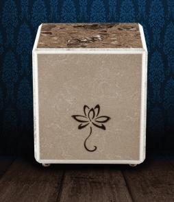 Urna cineraria in pregiato Marmo Trani e Napoleon Brown in scaglie con fiore inciso